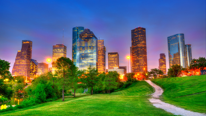 Houston Texas modern skyline at sunset twilight from park lawn HDRI