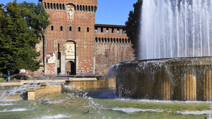 View of fountain and Castle tower in summer.