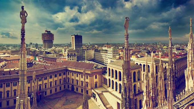 Milan, Italy panorama. View from Milan Cathedral. Royal Palace of Milan - Palazzo Realle and Velasca Tower in the background.