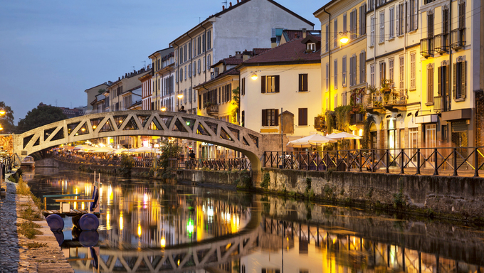 Bridge across the Naviglio Grande canal at the evening in Milan, Italy.