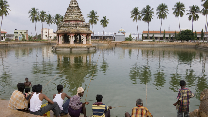 Local men fishing in the village of Karaikudi in the Chettinad area of the Tamil Nadu region of Southern India