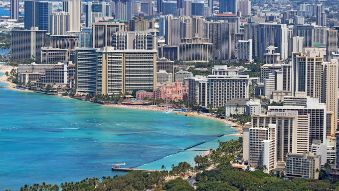 Close-up skyline of Honolulu, Hawaii showing the hotels and buildings on Waikiki Beach.