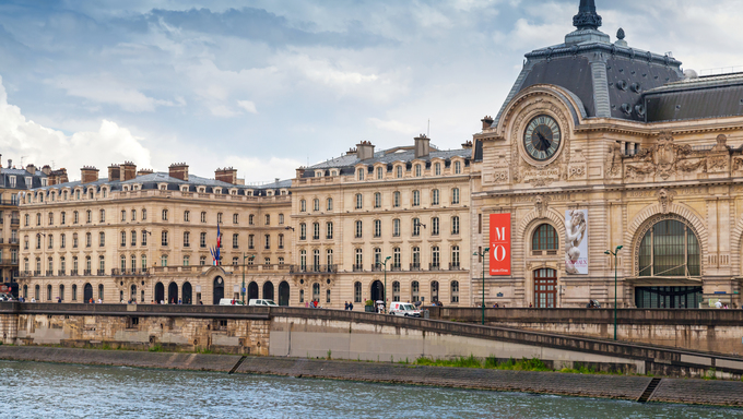 Seine river view and the facade of the Orsay modern art Museum in Paris, France.
