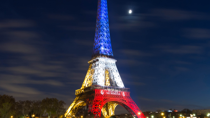 Pris, France-November 18, 2015 : The Eiffel tower lit up with the colors Of the French national flag (Blue, White and Red)to honor the victims of November 13 Friday's terrorist attacks in Paris(that killed 129 people).