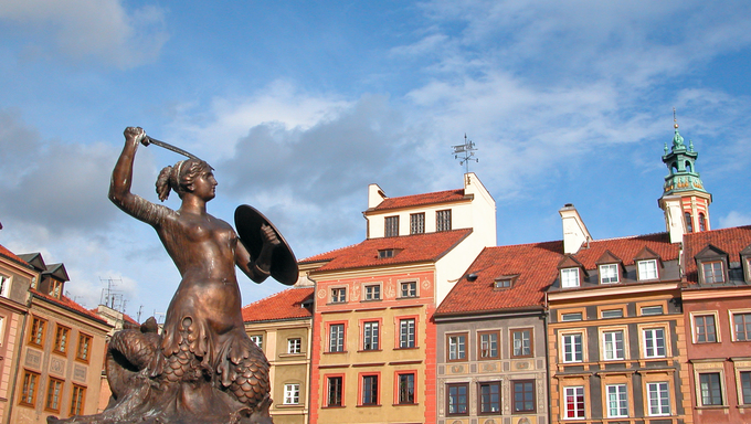 Statue of a Mermaid, the symbol of Warsaw. Old Town Square - Warsaw, Poland.