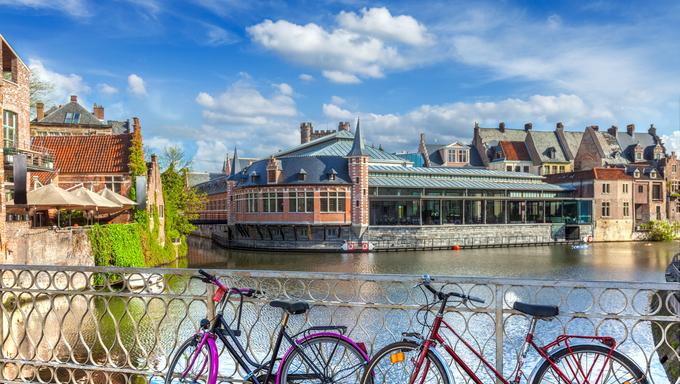 Bicycles in european town street in Ghent, Belgium.