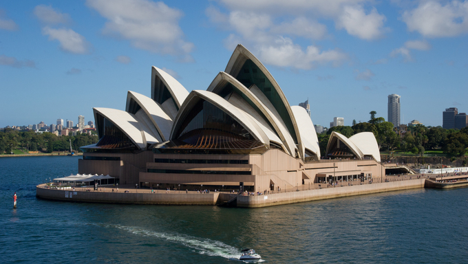 Sydney Opera House viewed from the ship in Sydney, Australia. The Sydney Opera House is a famous arts center. It was designed by Danish architect Jorn Utzon.