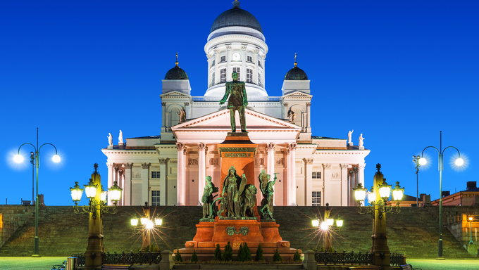 Famous landmark in Finnish capital: scenic night summer view of Senate Square with Lutheran cathedral and monument to Russian Emperor Alexander II