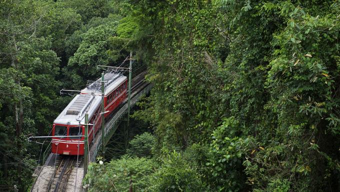 Red Brazilian Train Green Jungle Tijuca, Rio de Janeiro.