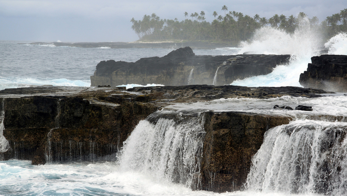 Rock and waves on the coast in amoa