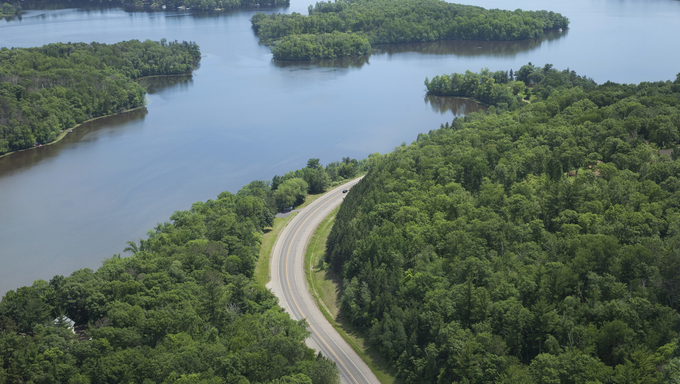 An aerial view of the Mississippi River and a curving road near Brainerd, Minnesota.