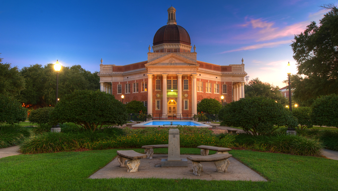 Southern Mississippi University campus admin building in pre-dawn light.