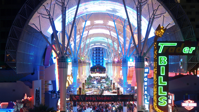 LAS VEGAS - MAY 7: Tourists flock to Fremont Streets free outdoor entertainment on May 7, 2010 in Las Vegas Nevada. Fremont street features overhead light shows nightly.