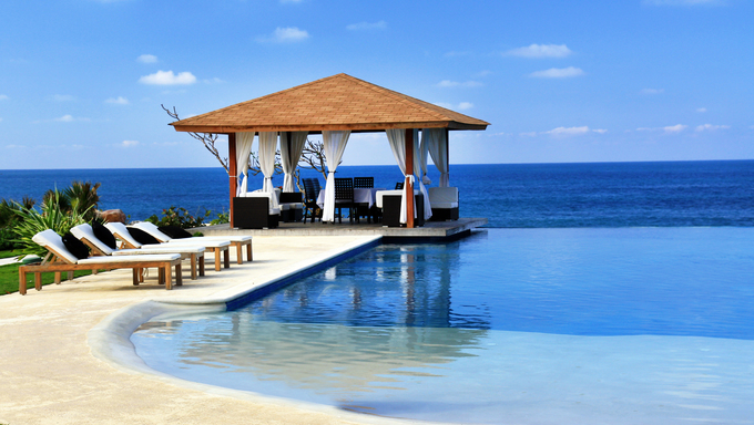 Pavilion and swimming pool in a luxury resort.