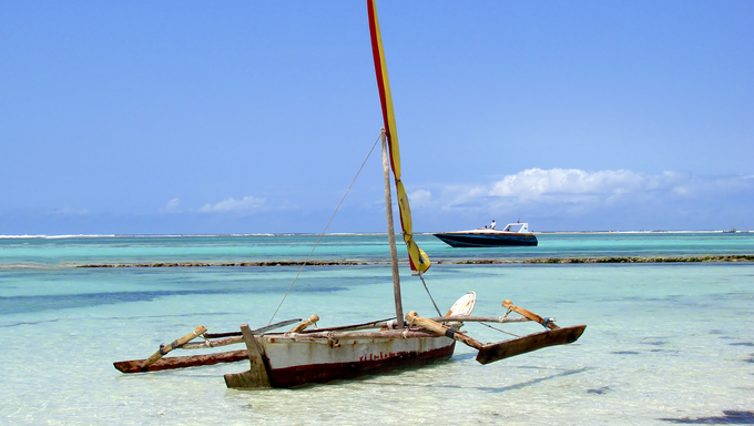 A Kenyan dhow moored on the shore.
