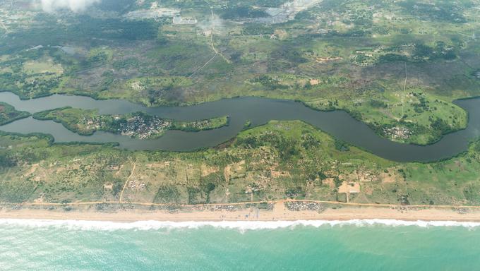 Aerial view of the Atlantic Ocean coastline along the shores of Cotonou, Benin.