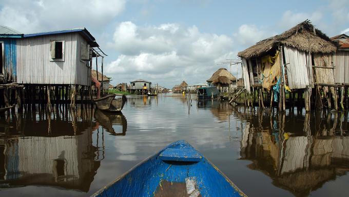 Canoeing through the stilt village of Ganvie in Benin.