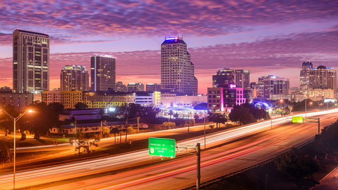 Orlando, Florida, USA downtown cityscape over the highway.