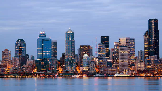 Seattle skyline in Washington USA. Buildings along waterfront at twilight.