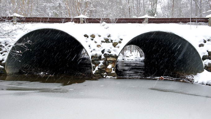 Snow covered storm water drainage tunnel in Richmond, Virginia during a winter storm.