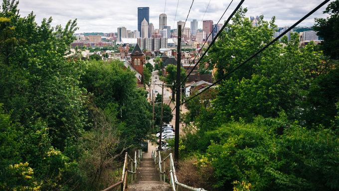 Staircase and view of the skyline in Pittsburgh, Pennsylvania.