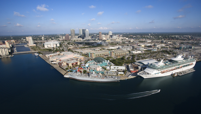 Aerial view of the Tampa Bay Area, with water and a cruise ship.