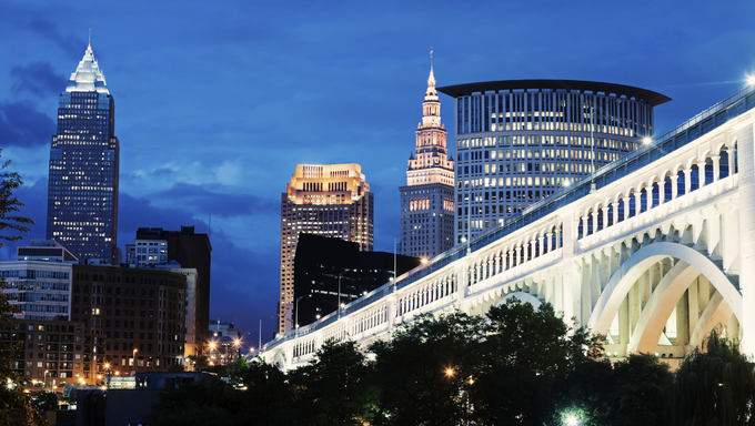 Cleveland skyline with bridge over Cuyahoga River.