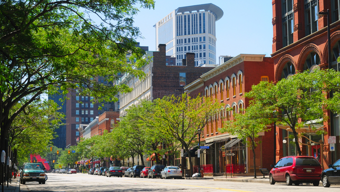 A street in downtown Cleveland Ohio's trendy Warehouse District, with the Justice Center rising behind.