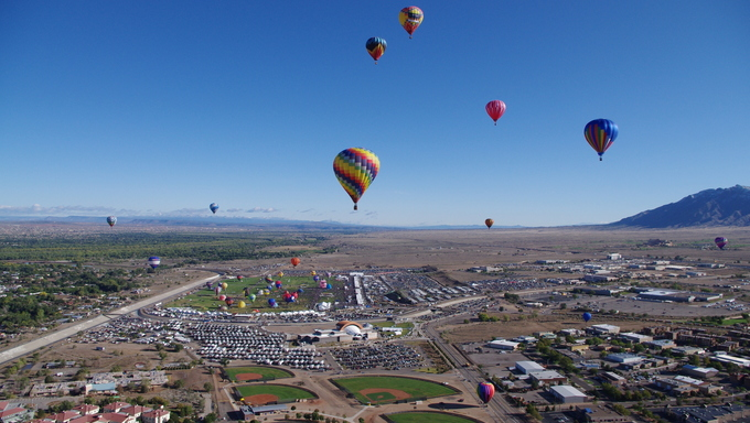 A mass ascension of balloons as seen from the air at the 40th edition of the Albuquerque International Balloon Fiesta.