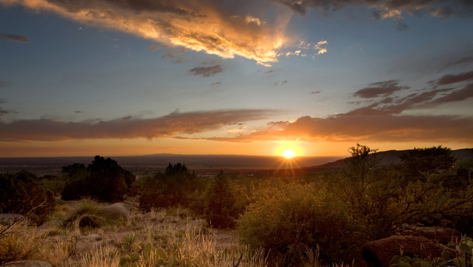A majestic sunset over the Chihuahuan Desert at the base of the Sandia Mountains, outside of Albuquerque, New Mexico.