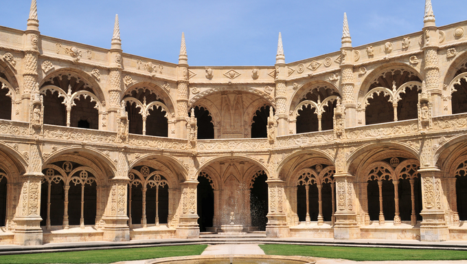 Portugal, Lisbon: Manueline architecture style, Jeronimo monastery; sculpted white stone with carved walls, statues and row of archs.