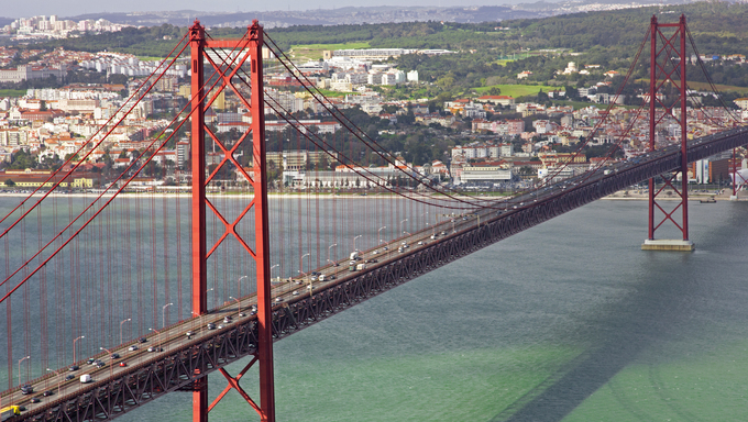 Portugal. Lisbon. The 25th of April Bridge through the river Tagus