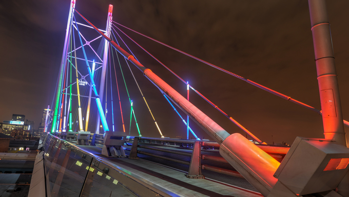 Nelson Mandela Bridge at night. The 284 metre long Nelson Mandela Bridge, officially opened by Nelson Mandela himself, which crosses over the 40 railway lines that lie spread beneath its span.