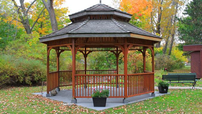 Wooden gazebo surrounded by colorful Fall foliage on Toronto Island.