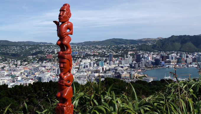 An ancient Maori sculpture of man and a woman made out of wood on top of Mt. Victoria in Wellington, New Zealand.