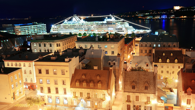 Cruise ship and lower town old buildings in Quebec City at night.