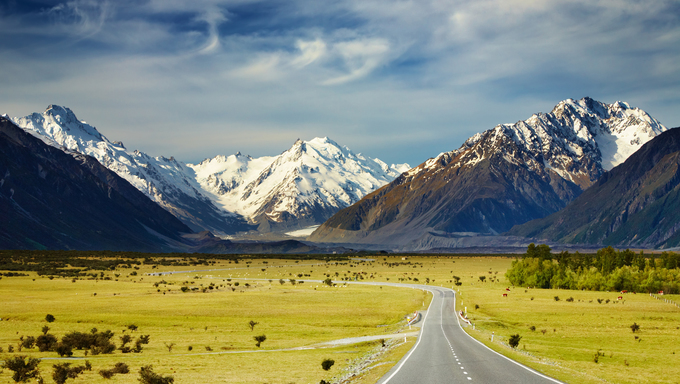 Landscape with road and snowy mountains, Southern Alps, New Zealand.