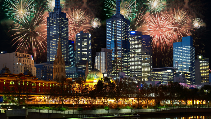 Fireworks and night illumination in Melbourne city.