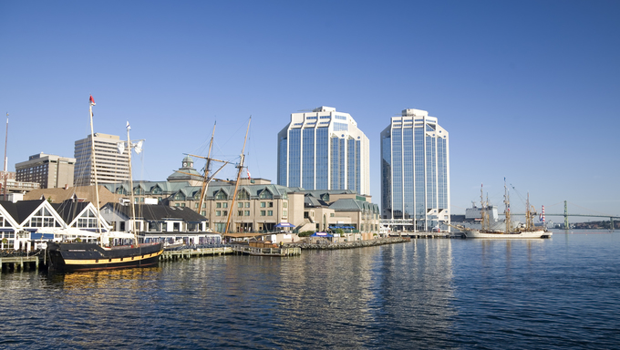 Tall ships docked in the early morning on Halifax's waterfront at Purdy's Wharf.