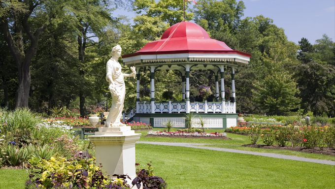 A bandstand gazebo and a statue of the Roman goddess Flora at the Halifax Public Gardens.