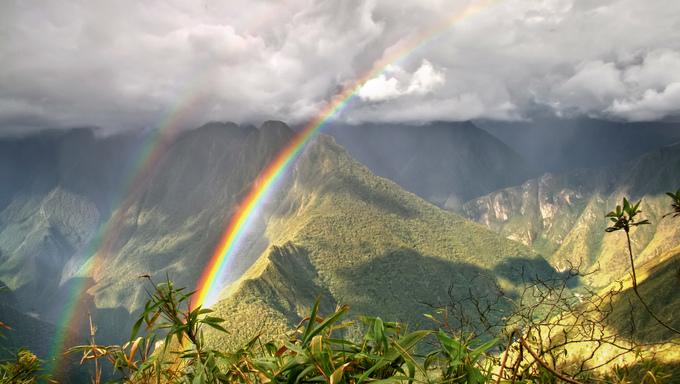 Rainbows in the mountains of Machu Picchu, Cusco, Peru.