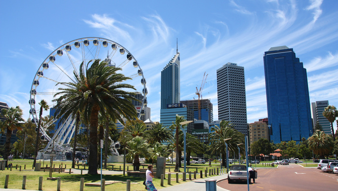 PERTH, AUSTRALIA - FEBRUARY 6: Tourist walks downtown on February 6, 2008 in Perth, Australia. There were 5.9 million visitor arrivals for calendar year 2011 in Australia.