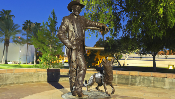 "SCOTTSDALE, ARIZONA - JUNE 10: The Scottsdale Civic Center on June 10, 2013, in Scottsdale, Arizona. A public sculpture, Mayor Herbert ""Herb"" Drinkwater and His Dog Sadie, by Clyde ""Ross"" Morgan."