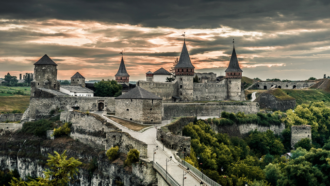 view on Kamenetz-Podolsky fortress at sunset,  Ukraine