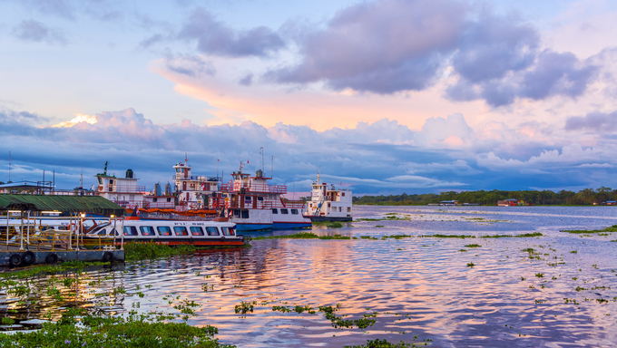 View of the port of Iquitos, Peru at sunset.  Iquitos is an Amazonian city with over 500,000 inhabitants.