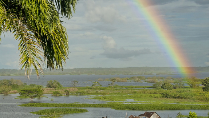 Rainbow over Amazon river near Iquitos, Peru.