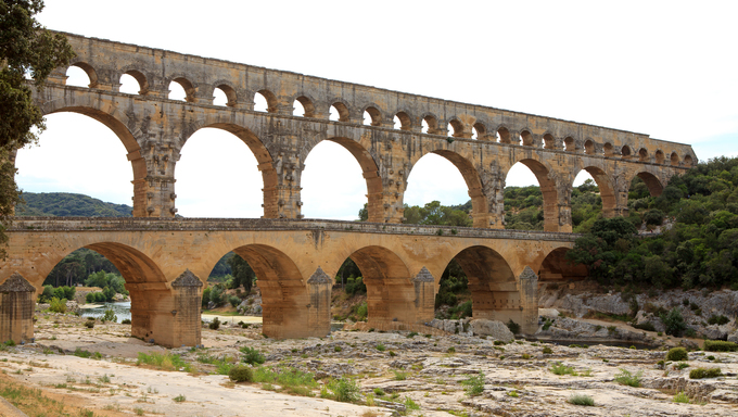 Scenic view of Roman built Pont du Gard aqueduct, Vers-Pont-du-Gard in South of France.