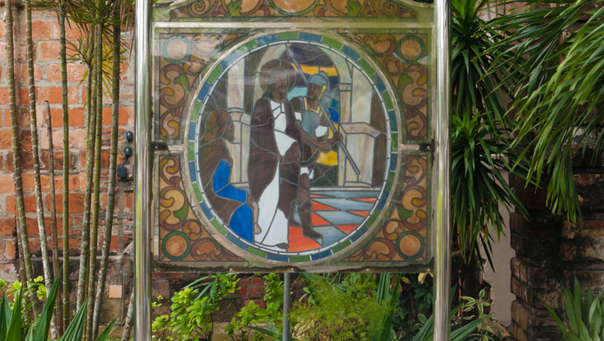 stained glass with religious text in Naga City, Philippines
