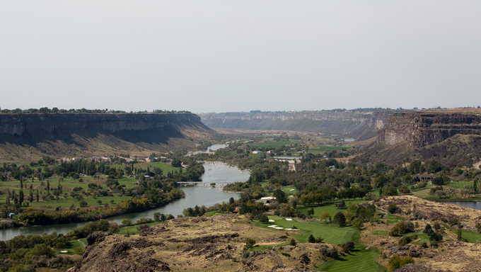 Scenic landscape view of the Snake River Canyon near Twin Falls, Idaho showing farms established through irrigation on the river banks in the valley running through the gorge.