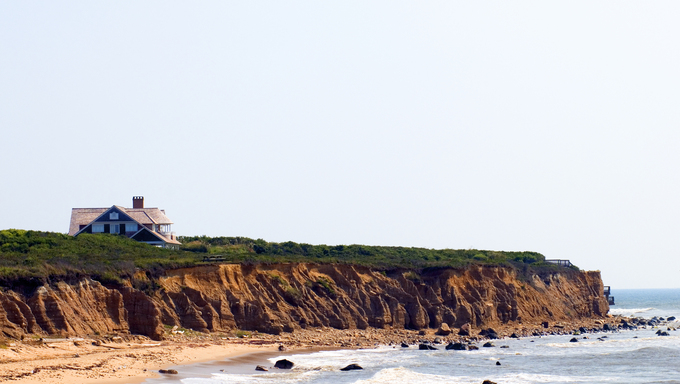 Mansion beach house over cliffs. Beach Montauk in Long Island, New York the Atlantic Ocean.